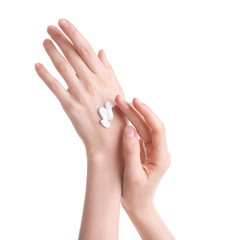 Young woman applying hand cream against on white background