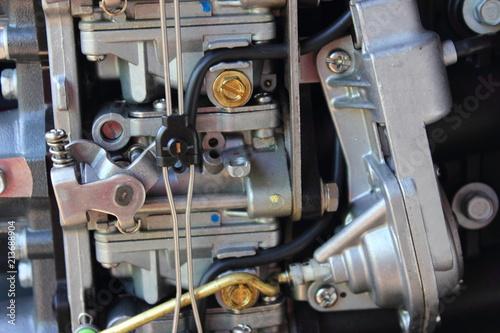 Carburetor and cold start acceleration pump close-up – maintenance