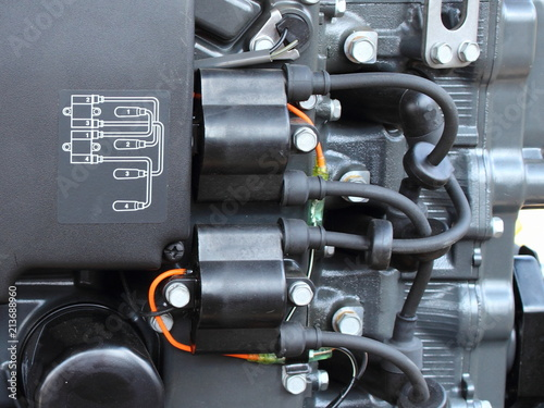 wiring diagram, ignition coils and high voltage wires with tips on  four-cylinder outboard motor