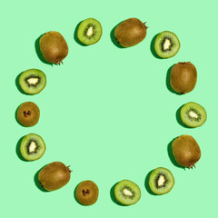 Kiwi fruit circle on a green background