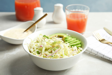 Bowl with healthy cabbage salad on marble table