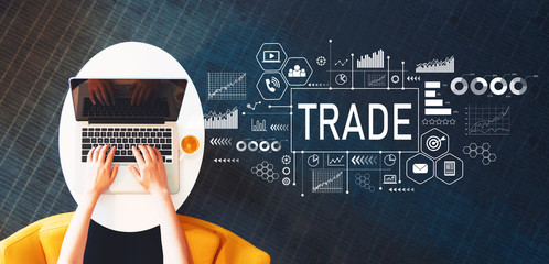 Trade with person using a laptop on a white table
