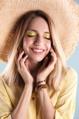 Beautiful young woman in hat, closeup. Summer fashion