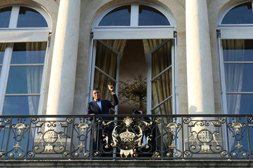 France's forward Kylian Mbappe gestures from the balcony of the Elysee Presidential Palace during an official reception at the Elysee Presidential Palace in Paris