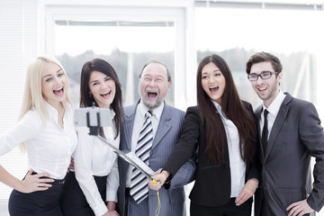 head and friendly business team taking selfie.
