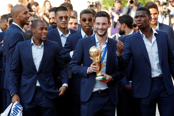 France soccer team captain Hugo Lloris holds the trophy with team mates before a reception to honour the France soccer team after their victory in the 2018 Russia Soccer World Cup, at the Elysee Palace in Paris