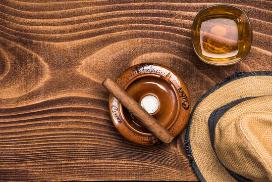 Objects related to Cuba on wooden background