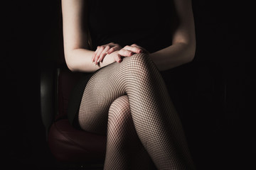 sexy women's legs in black fishnet stockings texture. woman knee in fishnet stockings
