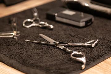 Closeup view of barbershop equipment on cotton towel