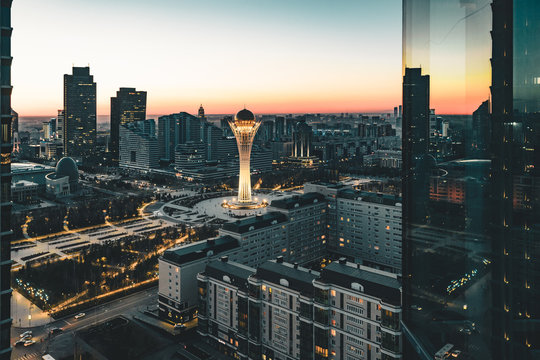 Night sunset sunrise view towards Bayterek tower and house of ministries in Nursultan Astana Kazakhstan on a clear day