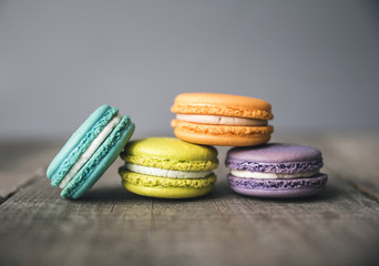 Close-up of colorful macaroons on wooden table