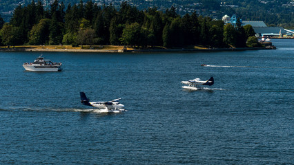 Hiroplanes about to land on water, near Canada Place, Vancouver, British Columbia, Canada.