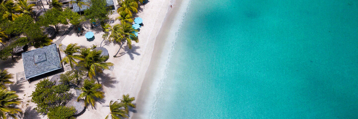 Aerial view of a white sand beach in carribbean island - banner