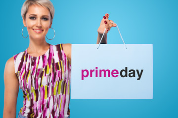 Shopping woman holding color bags isolated on blue background in black friday holiday. Summer shopping sale concept.