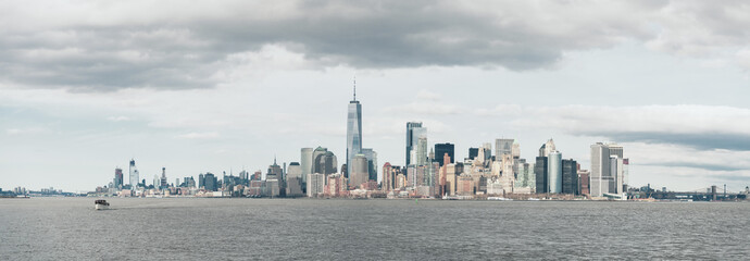 Panoramic view of cityscape by Hudson River against cloudy sky