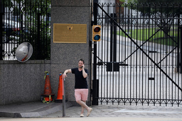 A man speaks on the phone outside the Russian Embassy in Washington