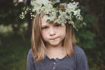 Portrait of girl wearing floral crown while standing outdoors