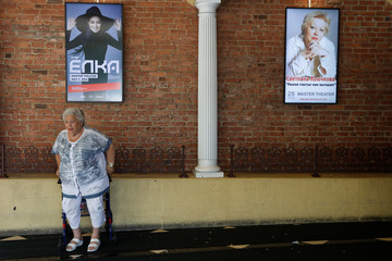 A woman stands at a movie theatre in the Brighton Beach section of Brooklyn, New York