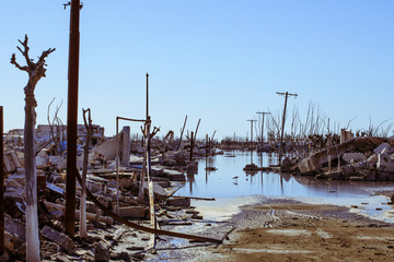 Demolished buildings against clear blue sky during Hurricane Harvey