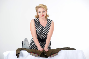 retro photo in 60's style, woman blonde in polka-dot dress with iron smooth military uniform of soviet times