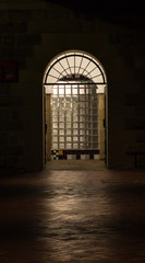 Illuminated doorway with arch and clear glass bricks at night
