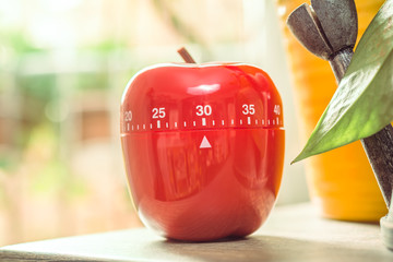 30 Minutes - Red Kitchen Egg Timer Next To A Windows And Flowerpots