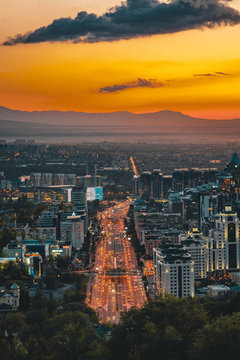 Sunset over the city of Almaty and a view of the Kok Tobe TV Tower