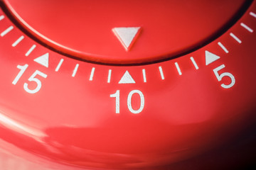 10 Minutes - Macro Of A Flat Red Kitchen Egg Timer