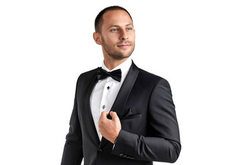 Serious man in a tuxedo on a white background. Isolated picture of the agent.