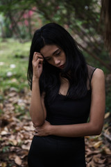 Stress Asian woman in  forest