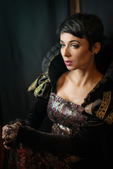Attractive girl in retro baroque style dress. Old fashion style.