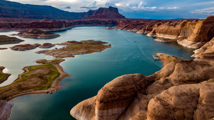 Aerial view of Lake Powell near Navjo Mountain, San Juan River in Glen Canyon with colorful buttes, skies and water