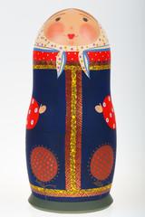 Real Russian nesting doll babushka matryoshka in sundress of Vladimir province isolated on white background