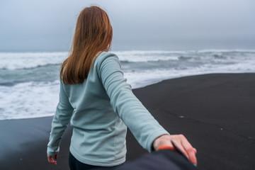 a woman leads her boyfriend on Kamchatka