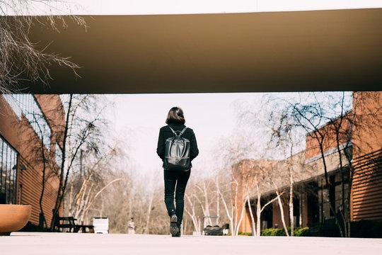 female student walks across campus