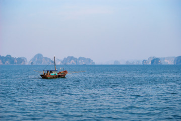 A small fishing boat in Halong bay. Vietnam