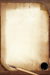 old paper on brown wood texture with pen for background