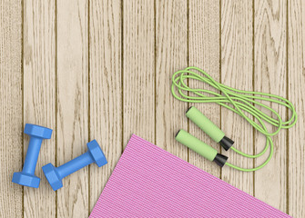 Fitness mat, dumbbells and jumping rope on wooden floor