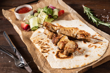 chicken kebab with salad
