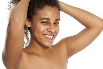 portrait of a happy young dark-skinned woman without makeup on a white background
