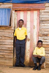 Little boys infront of their shack