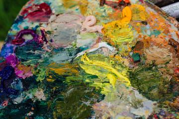 Close up palette with oil paints.