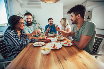 Group of multiethnic friends enjoying dinner party