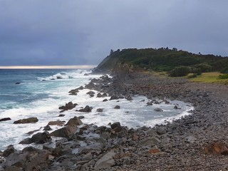 Wall Mural - Australian Coastline, Forster, Pebbly Beach with stormy seas