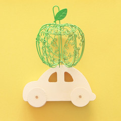 Flat lay image of green decorative apple over wooden car. Rosh hashanah (jewish New Year holiday) concept.