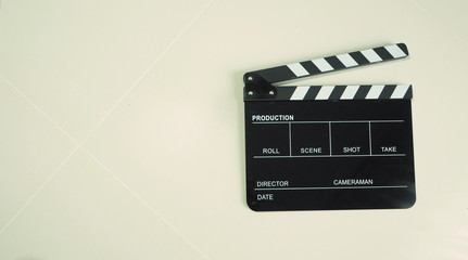 Clapper board or clap board or movie slate use in video production or movie and cinema industry. It's black color on white background. Top view angle.