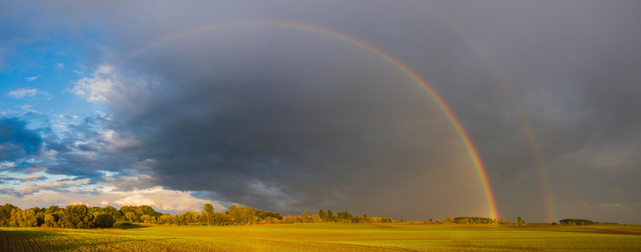 double rainbow in the evening sky over a field in Germany, Panorama