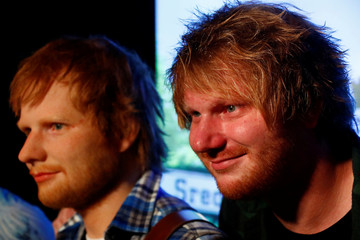 Nico Eckl, a lookalike of Ed Sheeran poses beside a wax figure of musician Ed Sheeran in the Madame Tussauds wax museum in Berlin