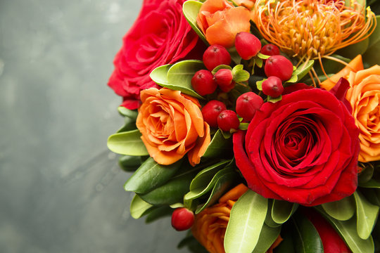 Winter or autumn bouquet with roses