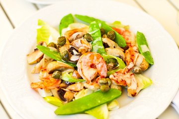 Salad with shrimps, mushrooms, capers with green peas